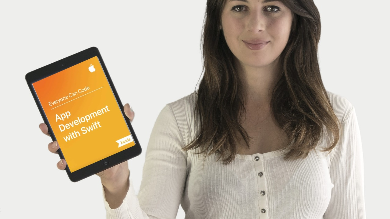 ipad med cover billede af ebogen App Development with Swift